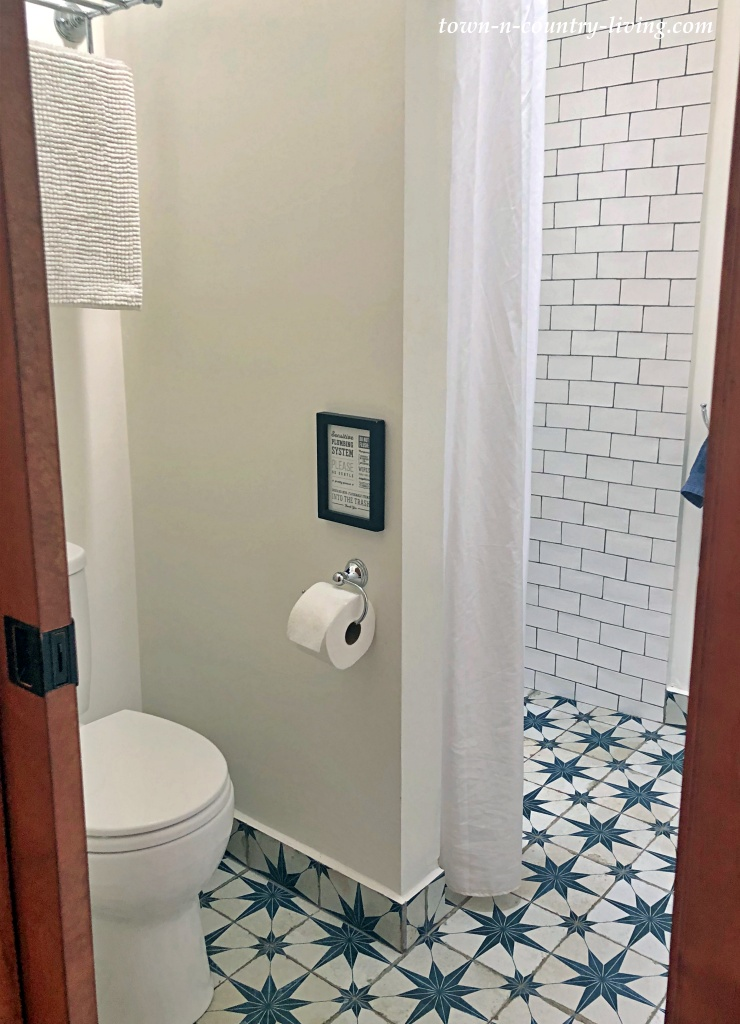 Small bathroom with custom tile floor in blue and white