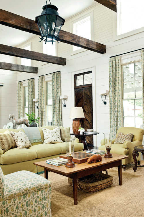 Beautiful neutral living room with vaulted beamed ceiling