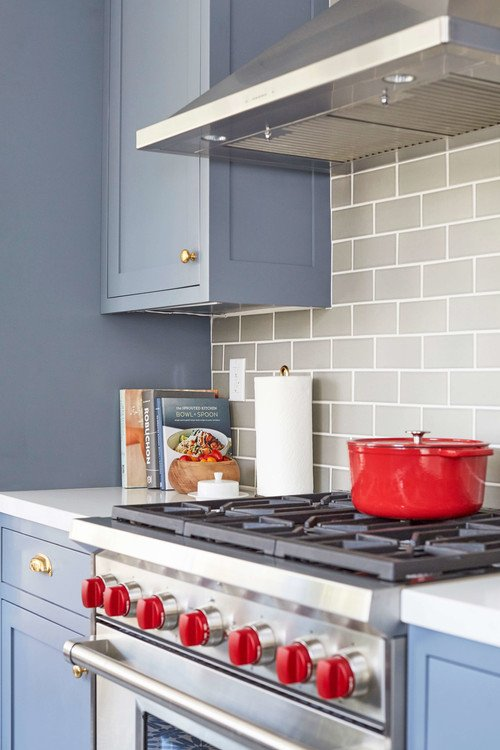 Stainless steel stove with red knobs