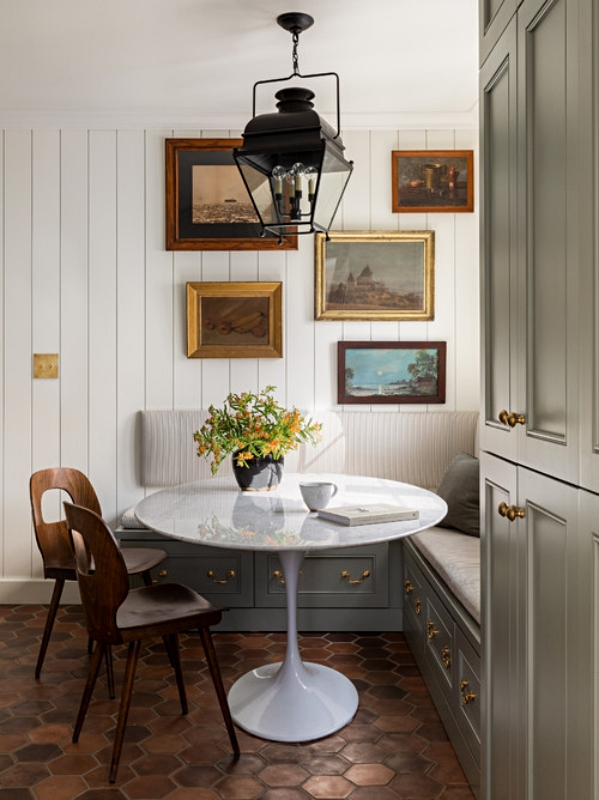 Breakfast Nook with Banquette and Wall of Oil Paintings