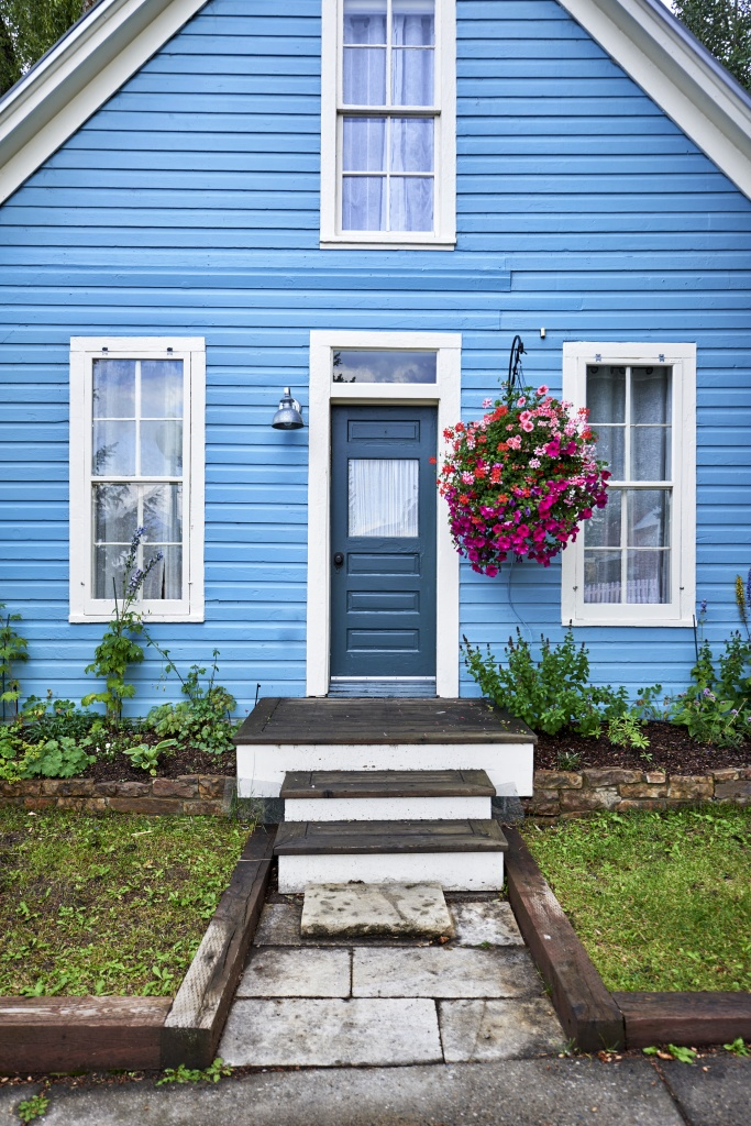 Colorful Blue House with Hanging Basket