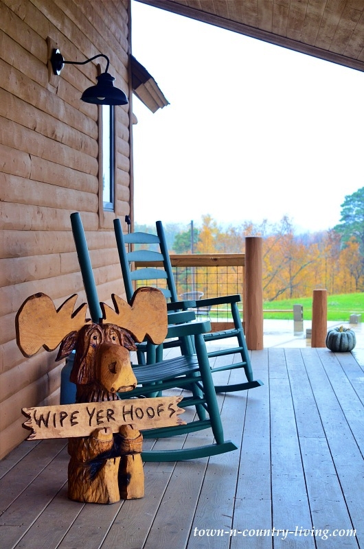 Wooden Moose Welcome on a Cabin Porch