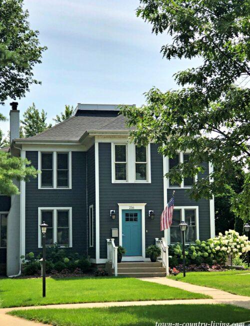 Dark Gray Clapboard Victorian Home with Turquoise Front Door