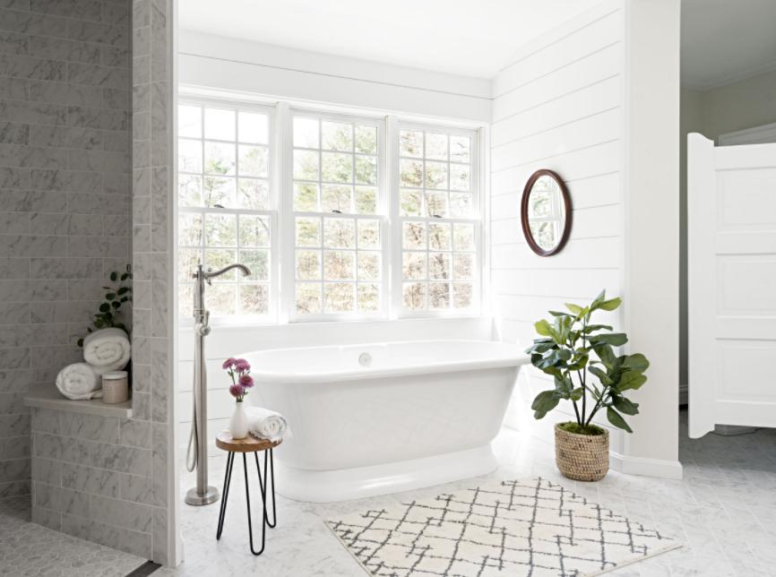 Free Standing White Tub in Farmhouse Style Bathroom