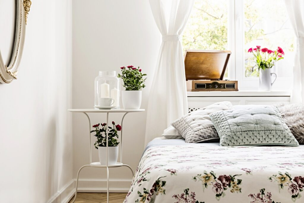 Floral bedspread in shabby chic bedroom