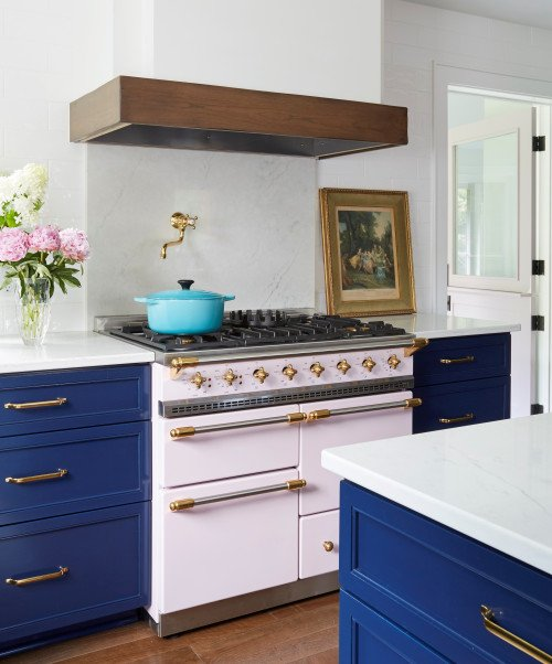 Navy Blue Cabinets in Farmhouse Kitchen with Vintage Stove