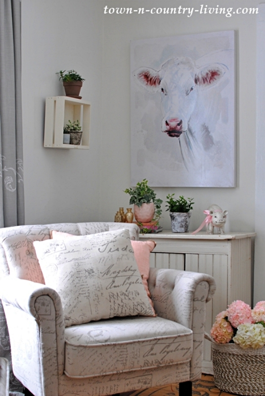 White Cow Painting in Small Living Room