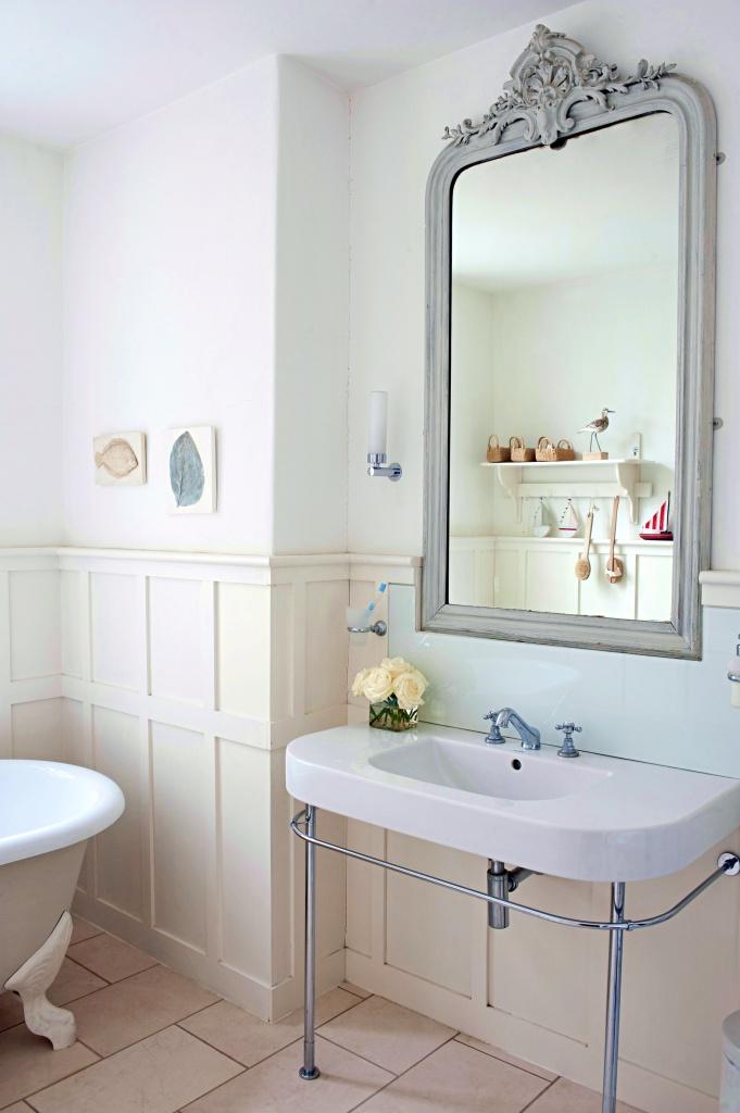 Gray painted vintage mirror above bathroom sink