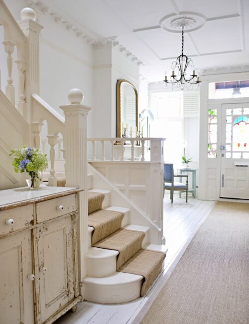 Entry hall with stairway and front door in old English home
