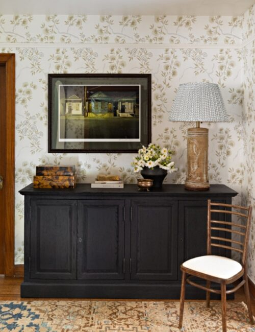 Wallpapered Entryway with Black Bachelor Chest