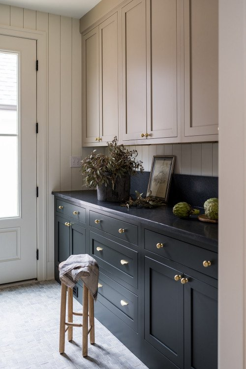 Butler's pantry with light tan upper cabinets and dark lower cabinetry