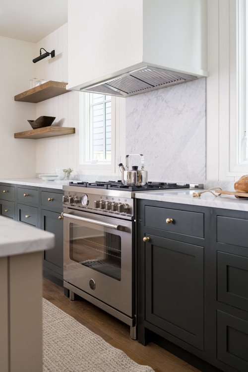 Stainless steel stove with marble backsplash
