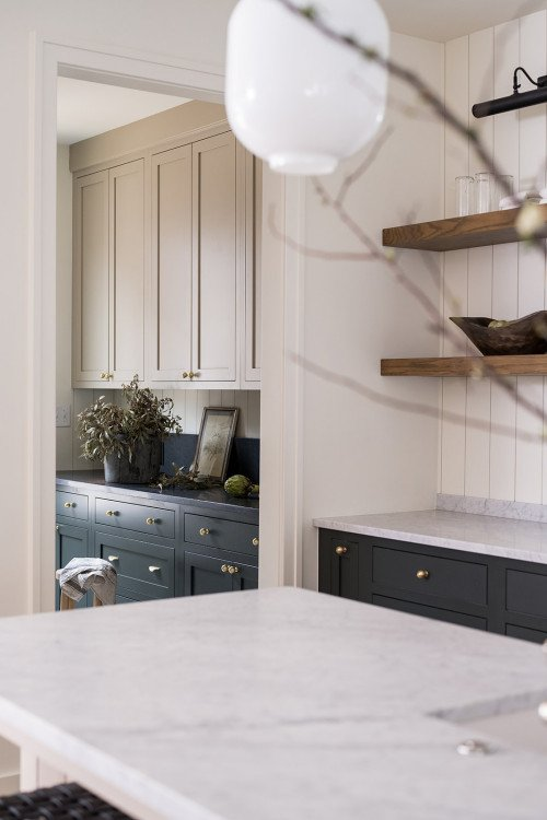 Modern farmhouse kitchen that opens into butler's pantry and entryway