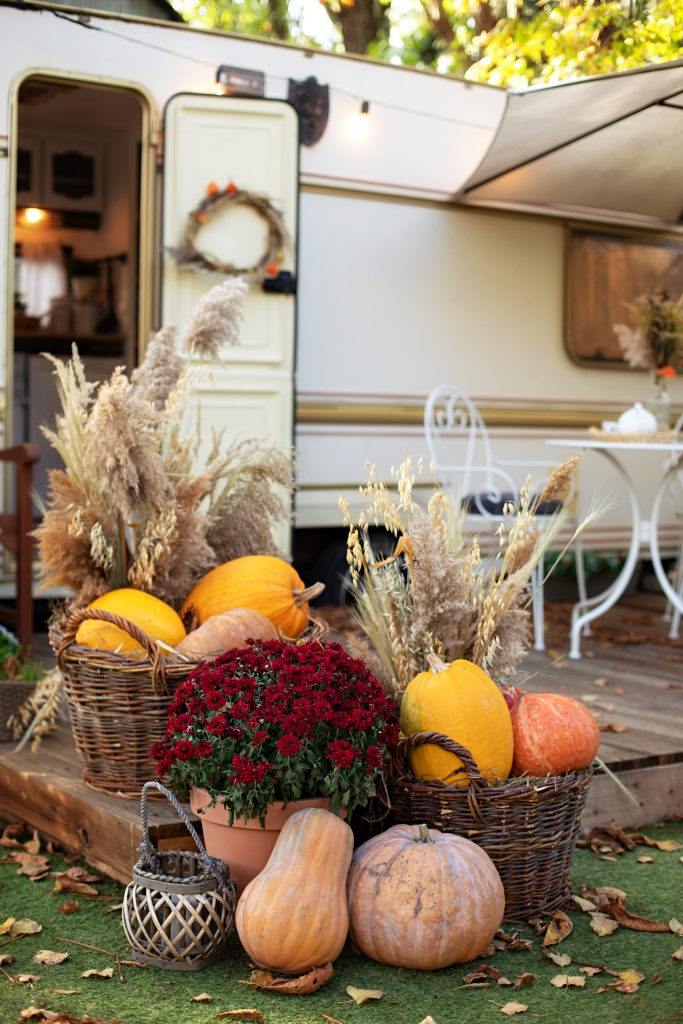 RV Camper with Deck Decorated for the Fall Season