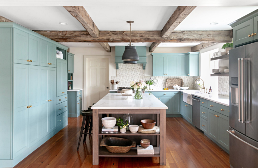Crisp Blue English Style Kitchen with Wood Ceiling Beams and Flooring