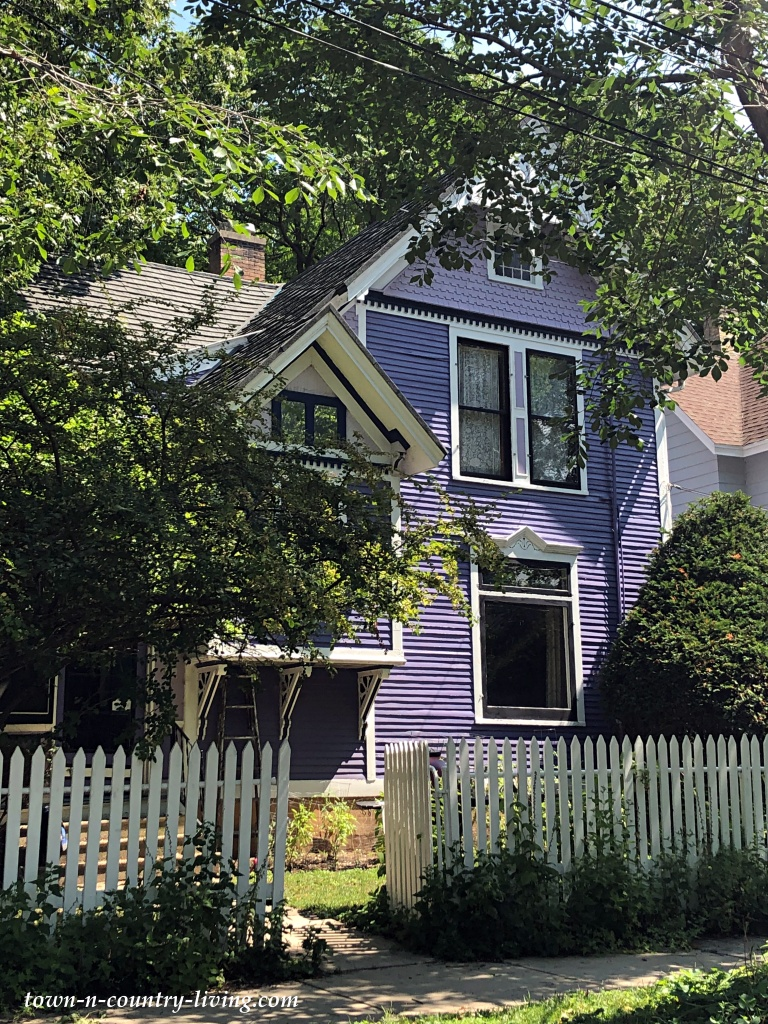 Purple Victorian Home with White Picket Fence