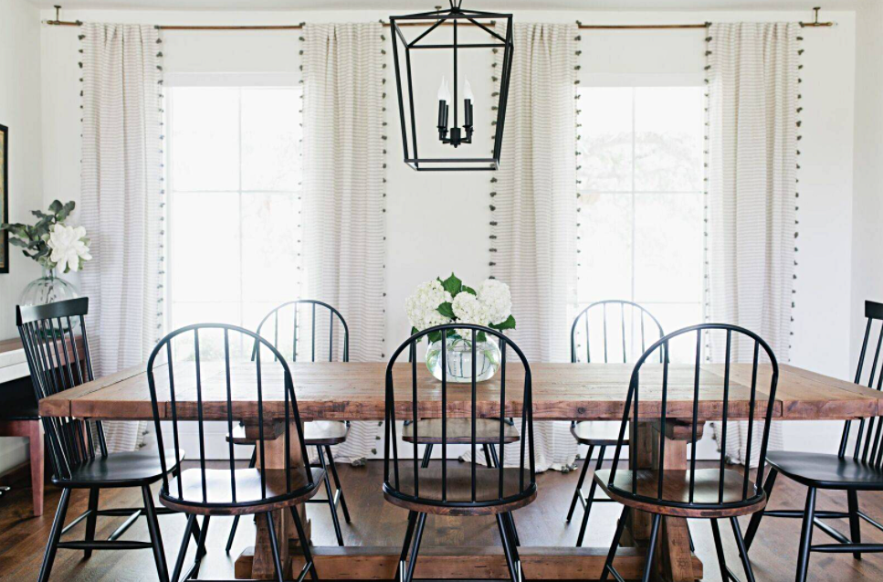 Black Windsor Chairs with Wooden Farmhouse Table in Dining Room