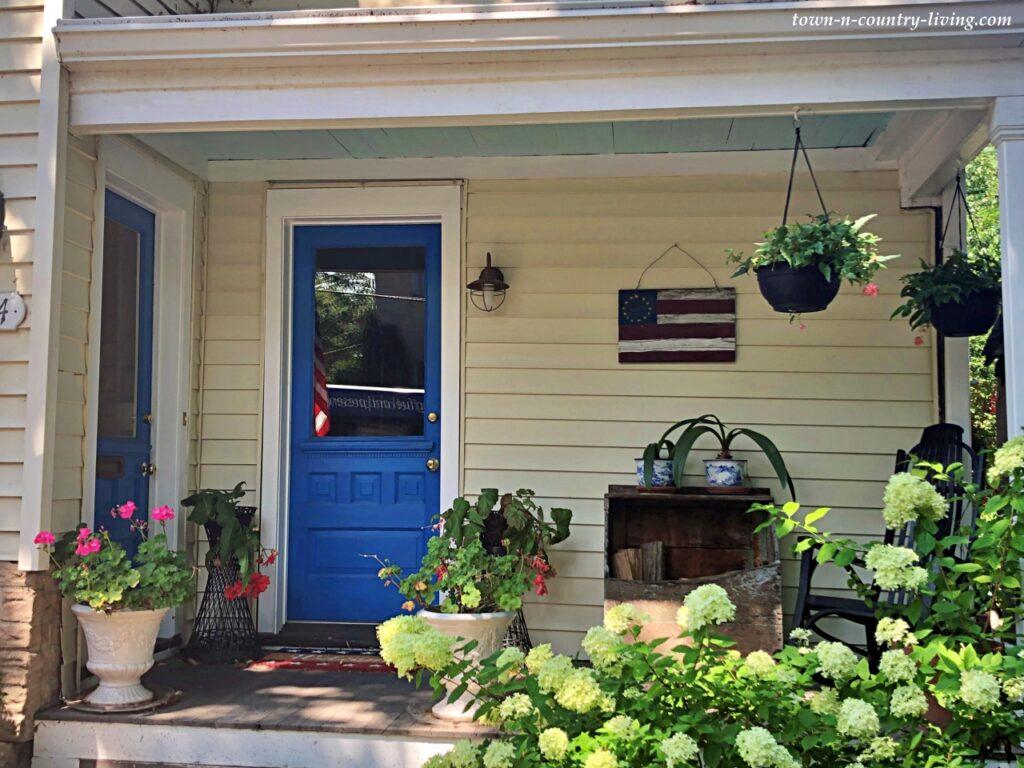 Farmhouse Porch with Bright Blue Door