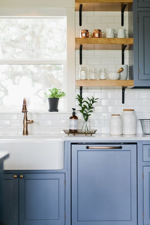 Wood open shelves in blue and white farmhouse style kitchen