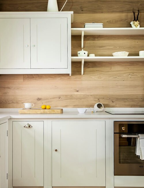 Light Wood Wall with White Kitchen Shelves and Cabinets