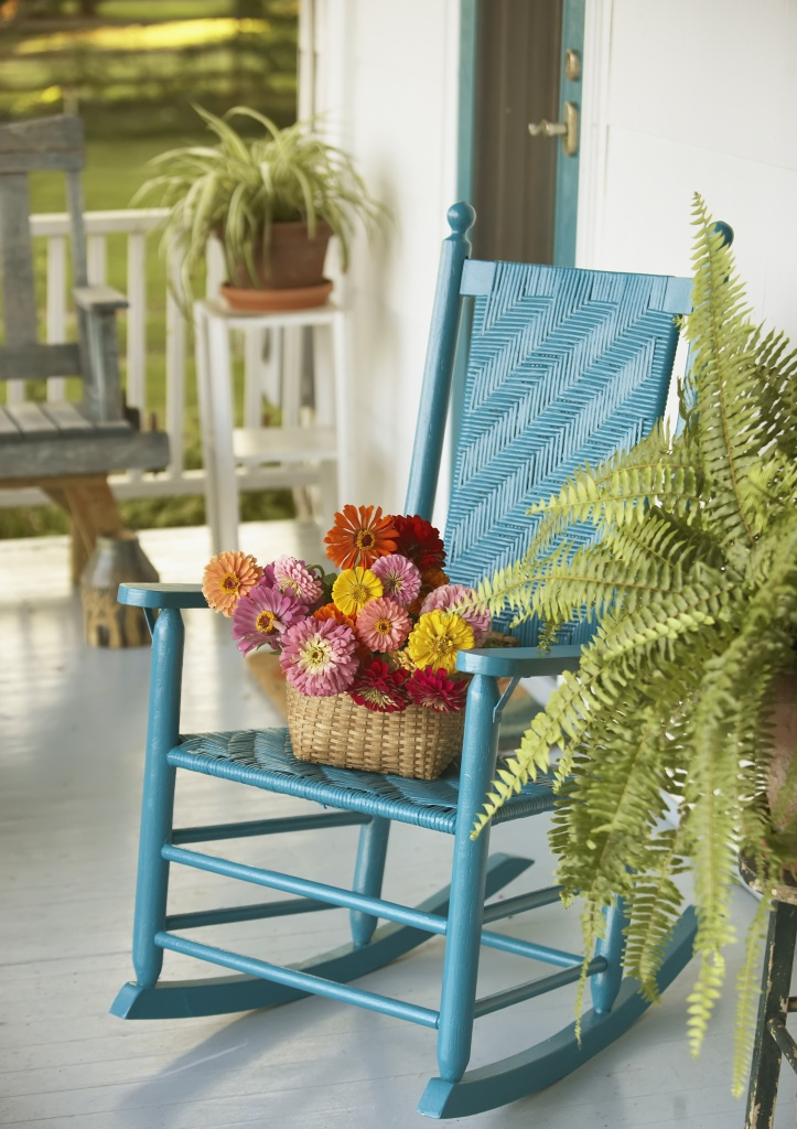 Basket of Flowers and Rocking chair on Porch.