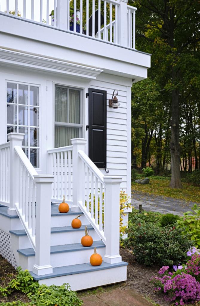 White Fall Porch with Small Orange Pumpkins