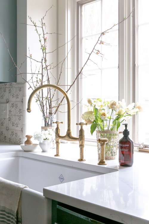 Golden gooseneck faucet in a traditional kitchen