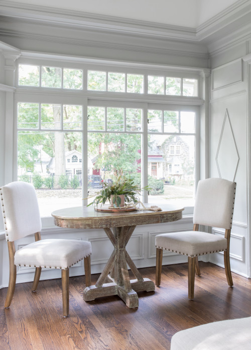 Small dinette in a white sunroom in a Colonial style house