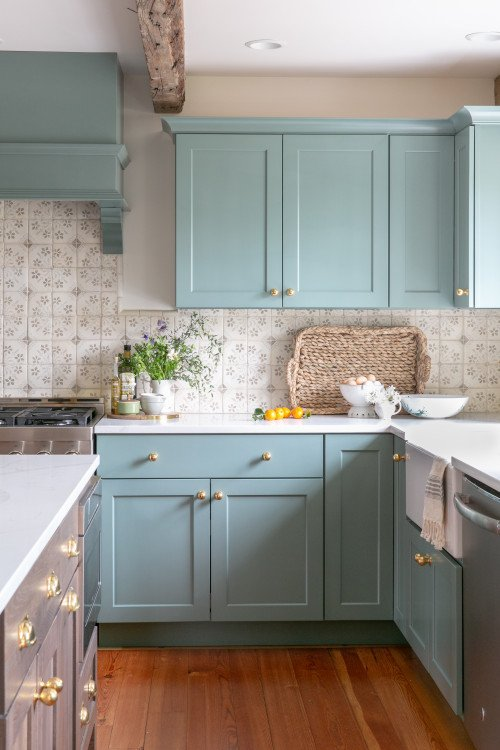 Pale blue kitchen cabinets in English style decor
