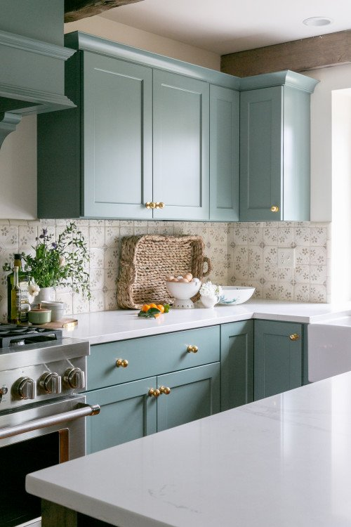 English style traditional kitchen with light blue cabinets