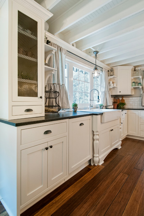 White Country Kitchen with Wood Floors and Painted Wood Ceiling