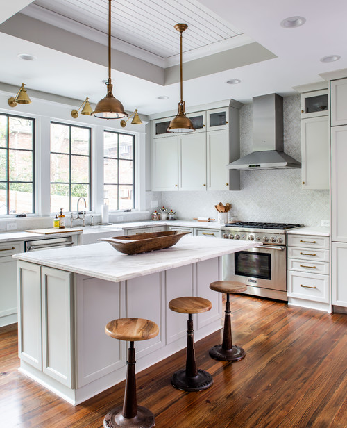 Farmhouse Style Kitchen with White Cabinets and Wood Floor
