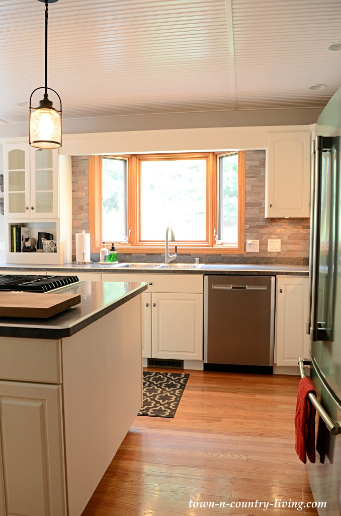 Wood floors in a traditional kitchen with an island and pendant lighting