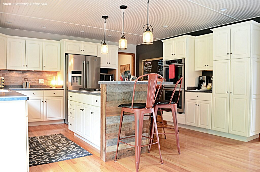 Farmhouse Kitchen in a Traditional House - with red bar stools at the counter
