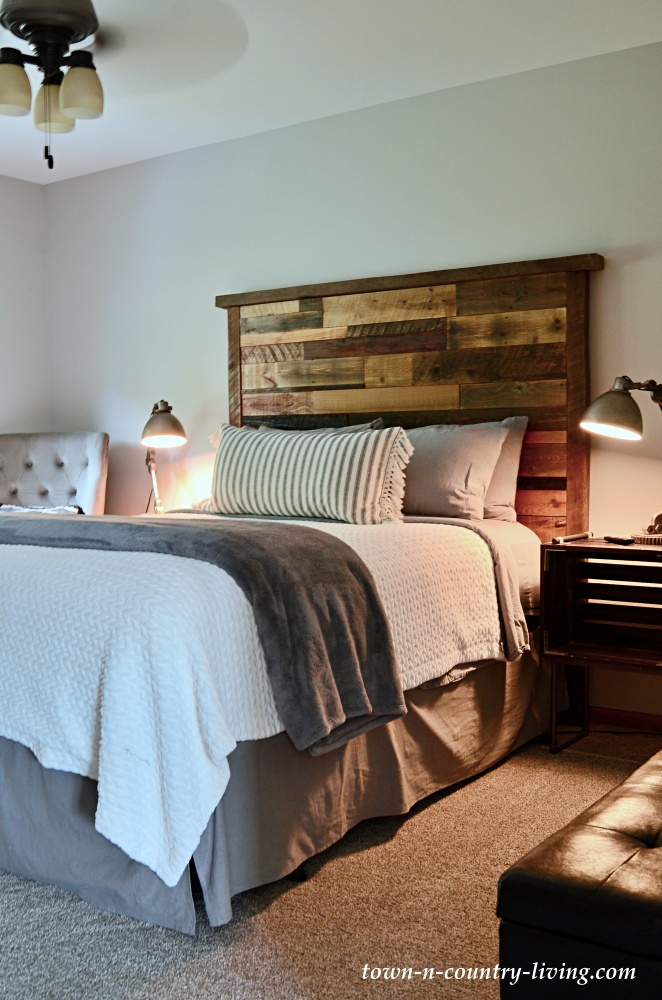 Small master bedroom with rustic wood plank headboard