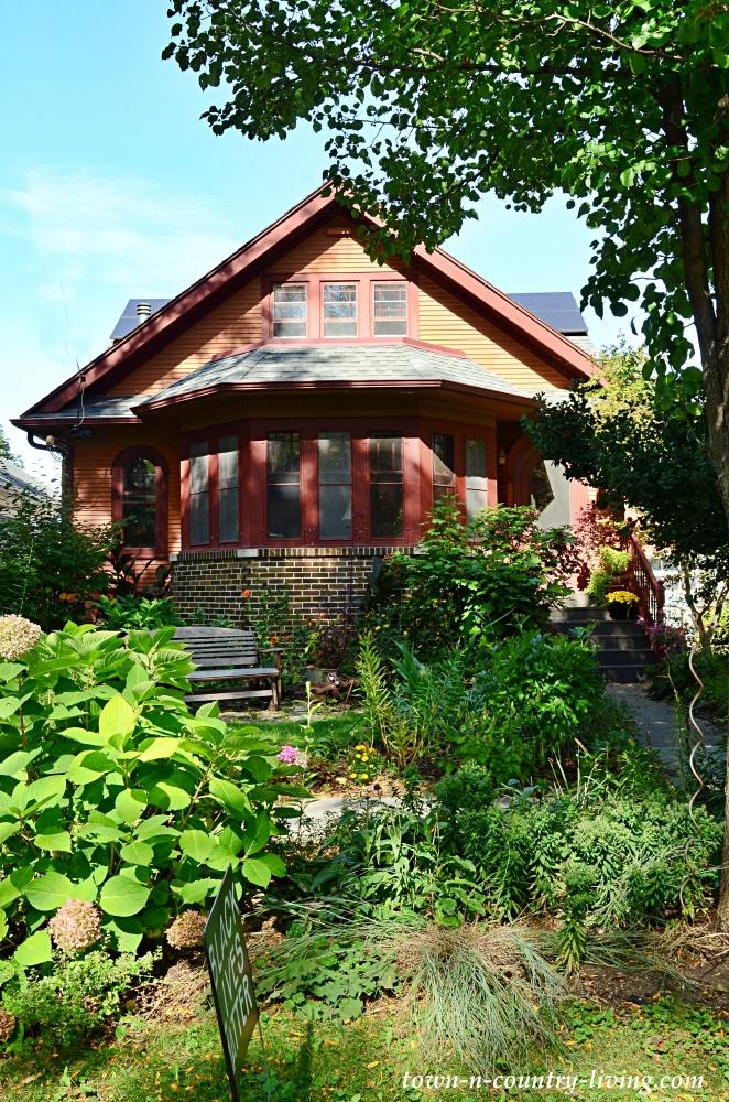 Brick bungalow on tree-lined street