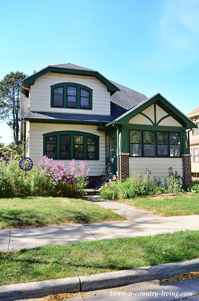 Stucco home with green trim