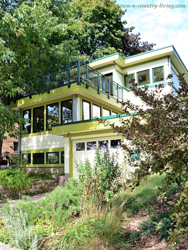 Stucco home with lime green trim