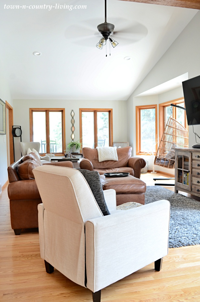 Tan Leather Couch and Chair in White Family Room