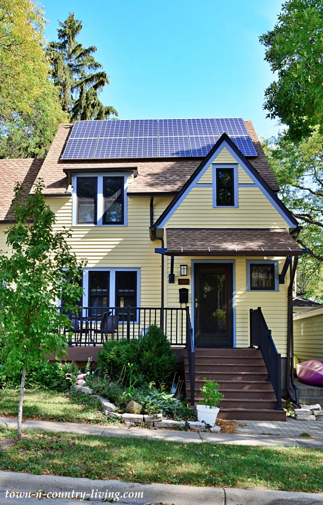 Yellow Cottage Home with Solar Panels on Roof