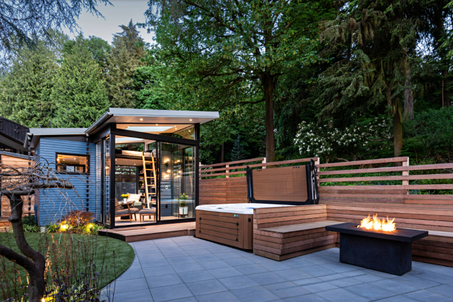 Paved patio with hot tub, fire pit, and outdoor reading retreat
