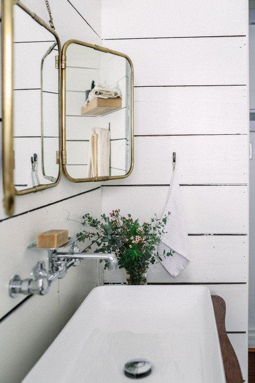 White shiplap walls in a vintage Texas bathroom