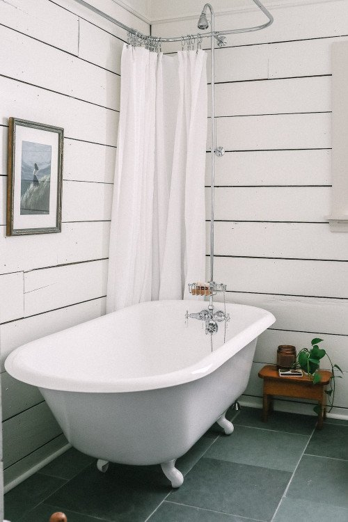 White claw foot tub with shower