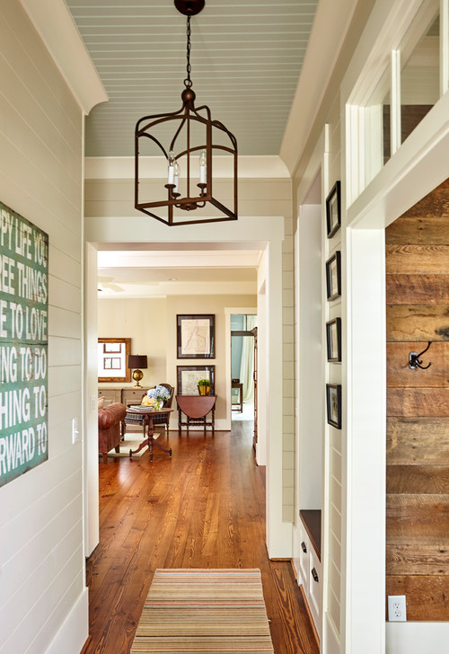 Front hall with painted shiplap walls and bead board ceiling
