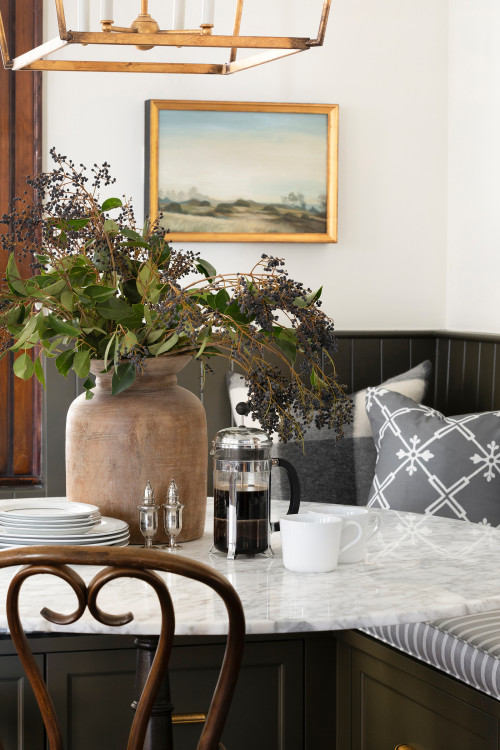 Warm and Cozy Dining Nook with Banquette and Ice Cream Parlor Chairs