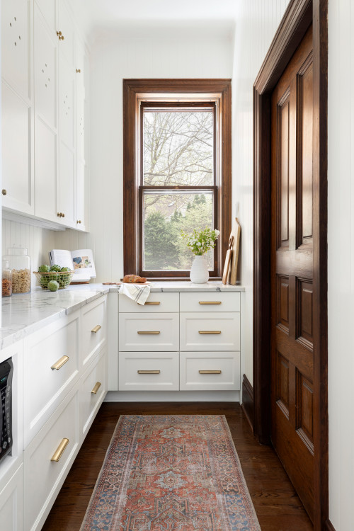 Kitchen pantry - white cabinets and wood trim