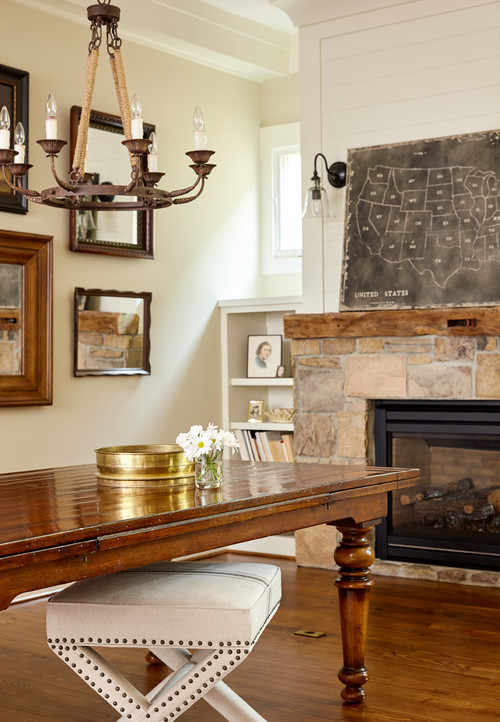 Country style dining room with stone fireplace in neutral tones