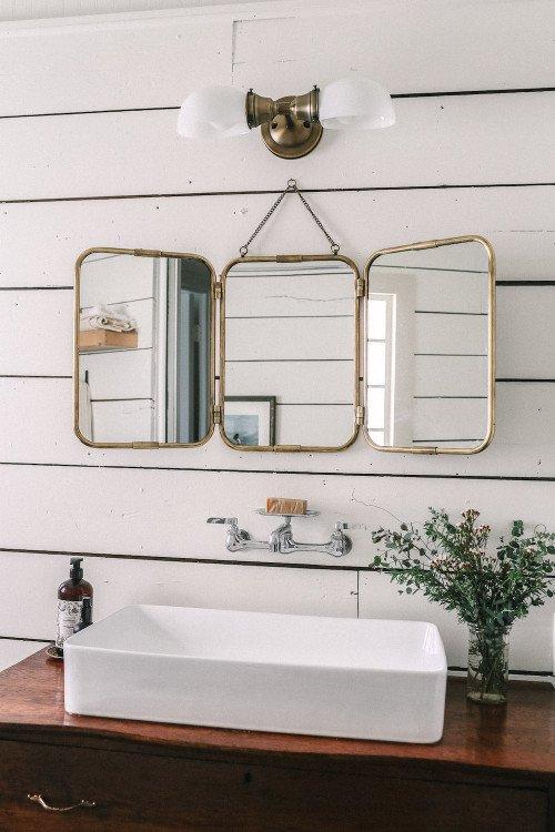 Triptych mirror in small vintage bathroom