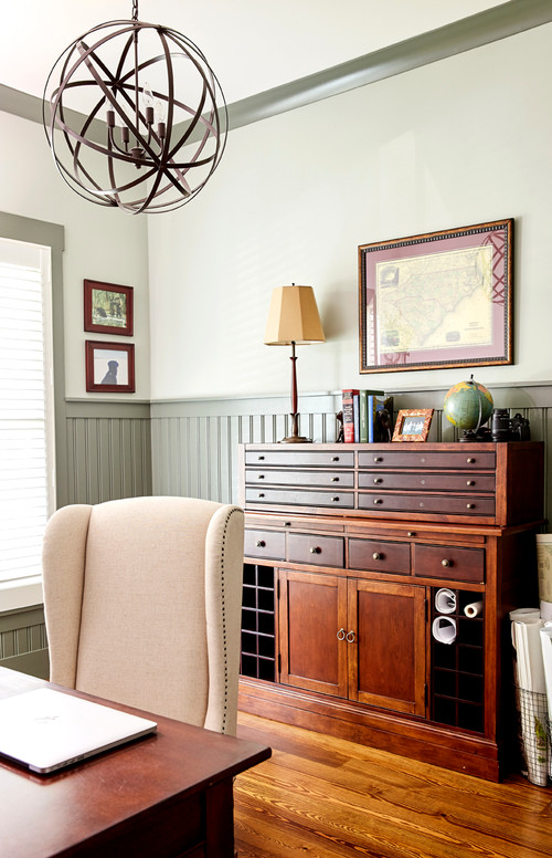 Vintage home office with painted bead board walls and wooden desk
