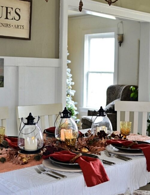 Fall table setting in gray and burgundy with lanterns